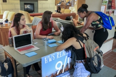 Lindsey Enchelmaier '17 and Rebecca Czajkowski '18 work with Divya Tewari '20 and Jackeline Matos '19 writing letters to the families of the September 11th victims.