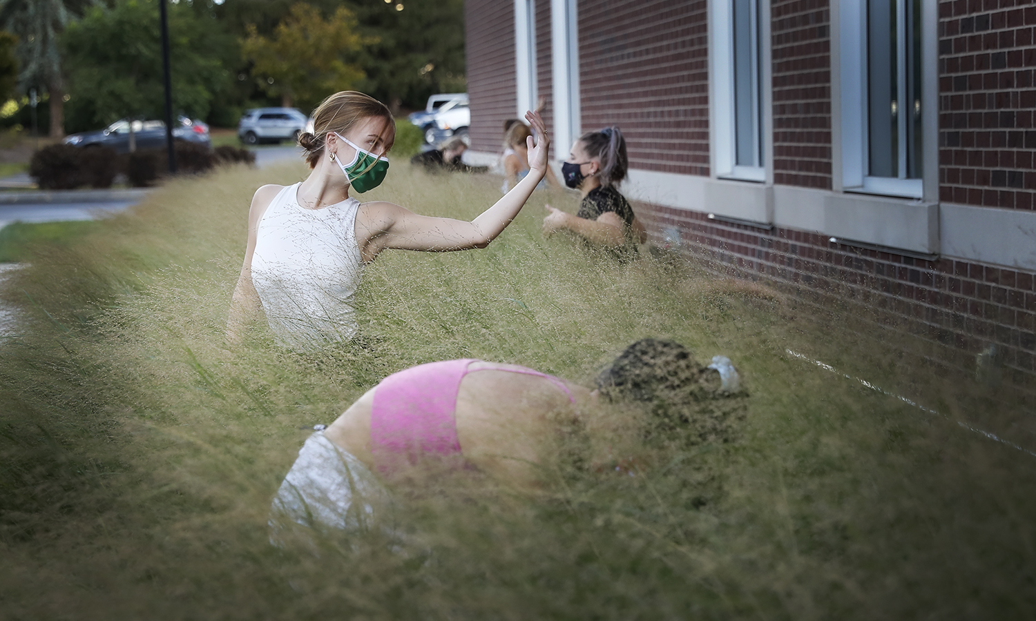 The Intermediate Modern Technique class taught by Associate Professor of Dance, Michelle Ikle, performed an Environmental Dance Map in front of the Gearan Center. The tall grasses provided a perfect landscape for a study in appearing and disappearing; relating self to self, self to other and self to environment.