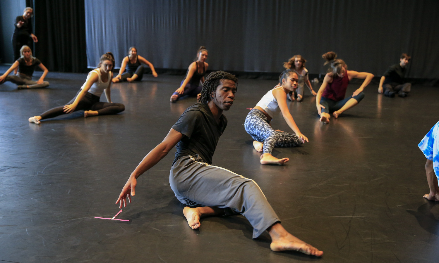 Cameron McKinney, Artistic Director of Kizuna Dance, leads a contemporary dance workshop inDeming Theatre of the Gearan Center for the Performing Arts.