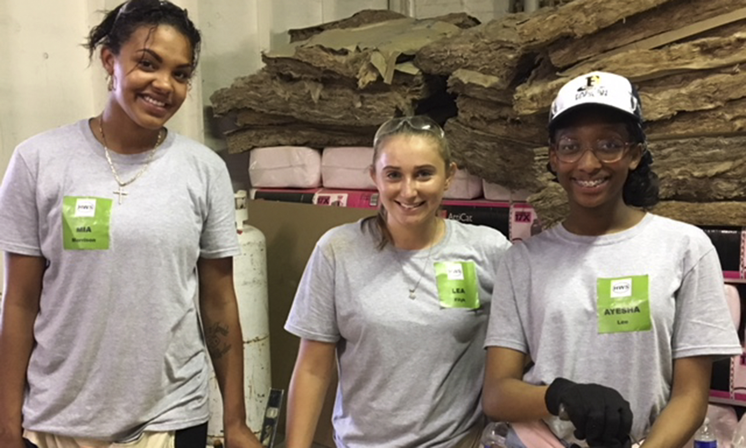 Recipients of the Farash Foundation First in Family Scholarship Mia Morrison '19, Lea Filyk '21 and Ayesha Lee '22 participate in Farash's Day of Service at Flower City Habitat for Humanity in Rochester, NY. The Max and Marian Farash Charitable Foundation funds this scholarship in order to allow local HWS students who are the first in their families to attend college reach their academic goals debt-free.