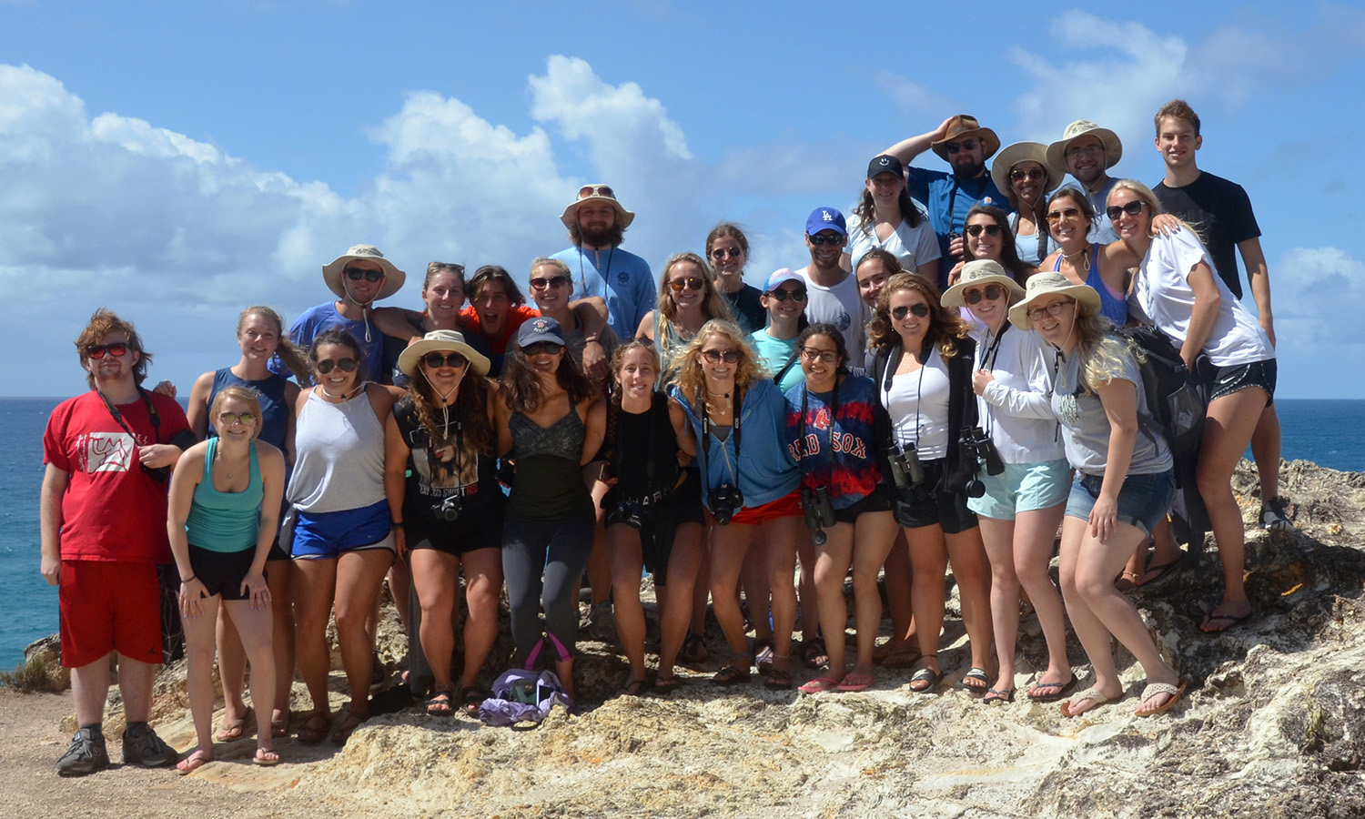 HWS and Union students studying abroad in Brisbane gather for a group photo on the beach.