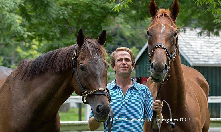 "Archibald J. Kingsley 'X poses for a photo with his winning horses ""Show Court"" and ""Boss Man"" at the Saratoga Race Course in Saratoga Springs, N.Y."
