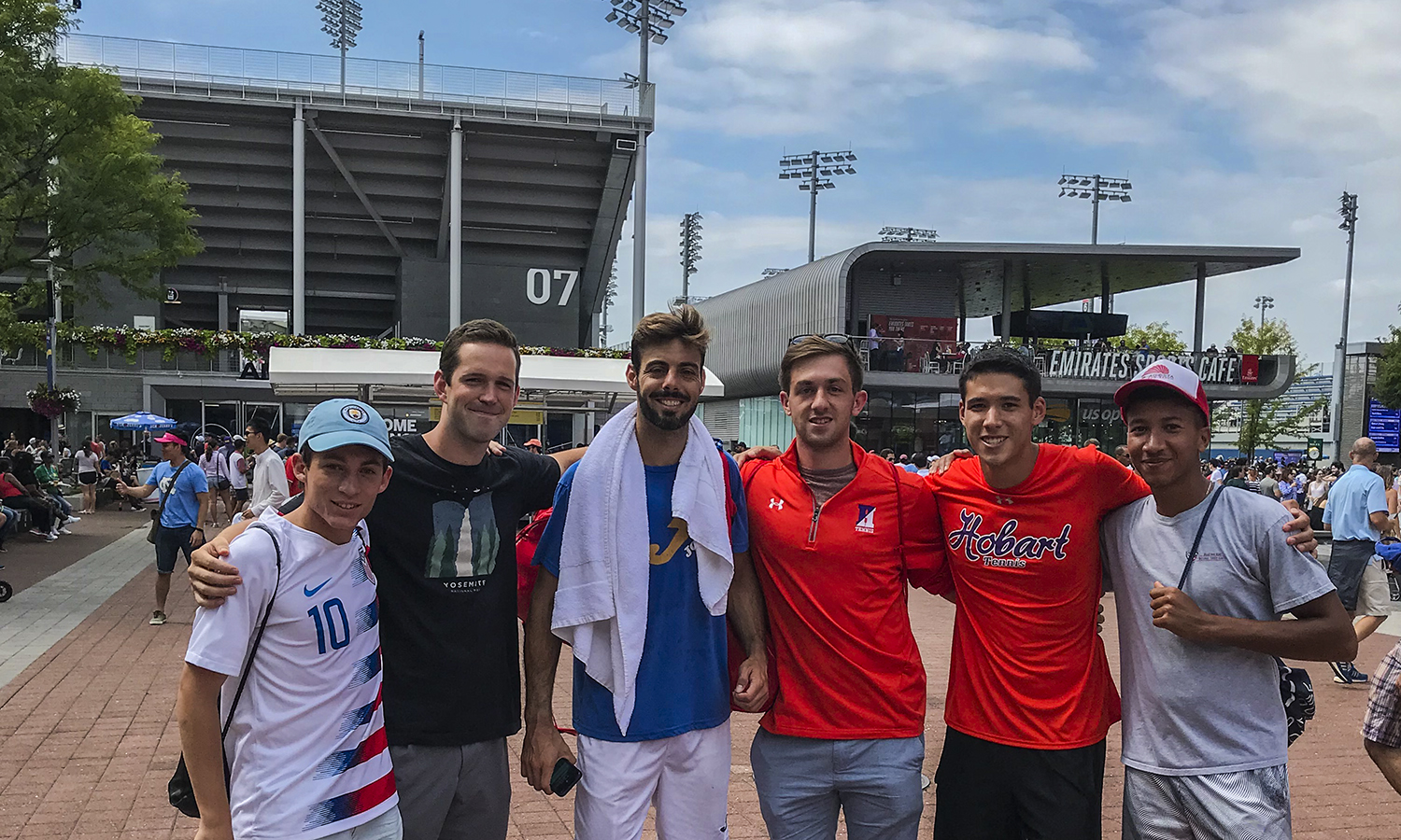 Adam Farid '20, Joe Mallon '20, Alan Dubrovsky '20, Thomas Shung '22 and Jonathan Atwater '19 pose for a photo with Professional Tennis Player Marcel Granollers (center) during a visit to the U.S. Open Tournament.