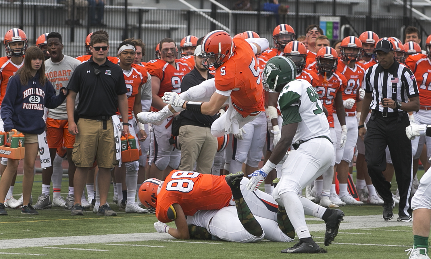 David Krewson 'X hurdles a defender during Hobart's 62-24 win over SUNY Morrosville on Saturday.