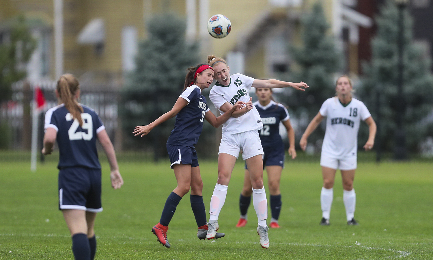 Katie Mandarano 'X battles a defender during the Heron's 3-0 win over the SUNY Geneseo Knights on Wednesday.