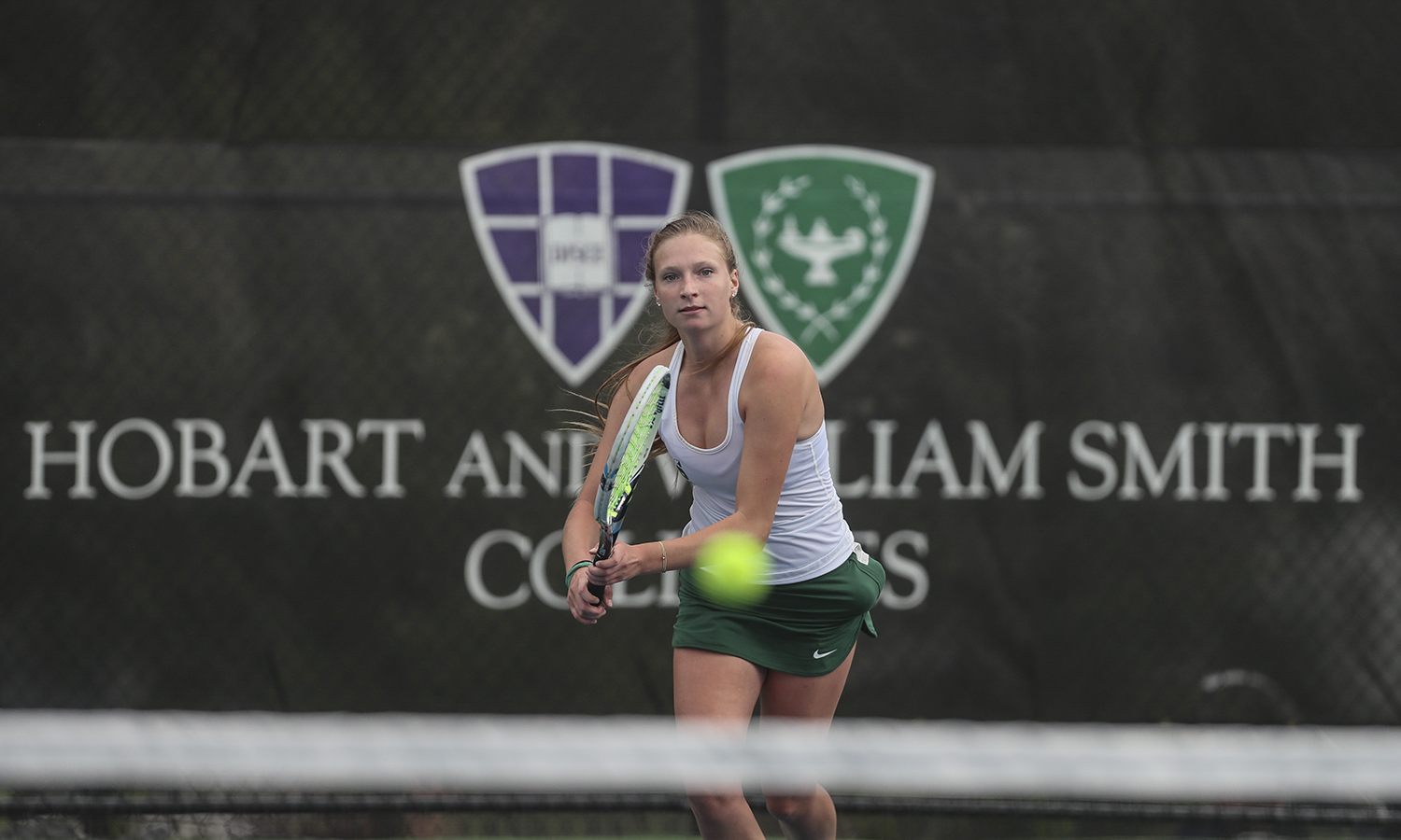 Charlotte Engebrecht '21 hits a backhand during the Mary Hosking Invitational in Geneva, N.Y. on Saturday.