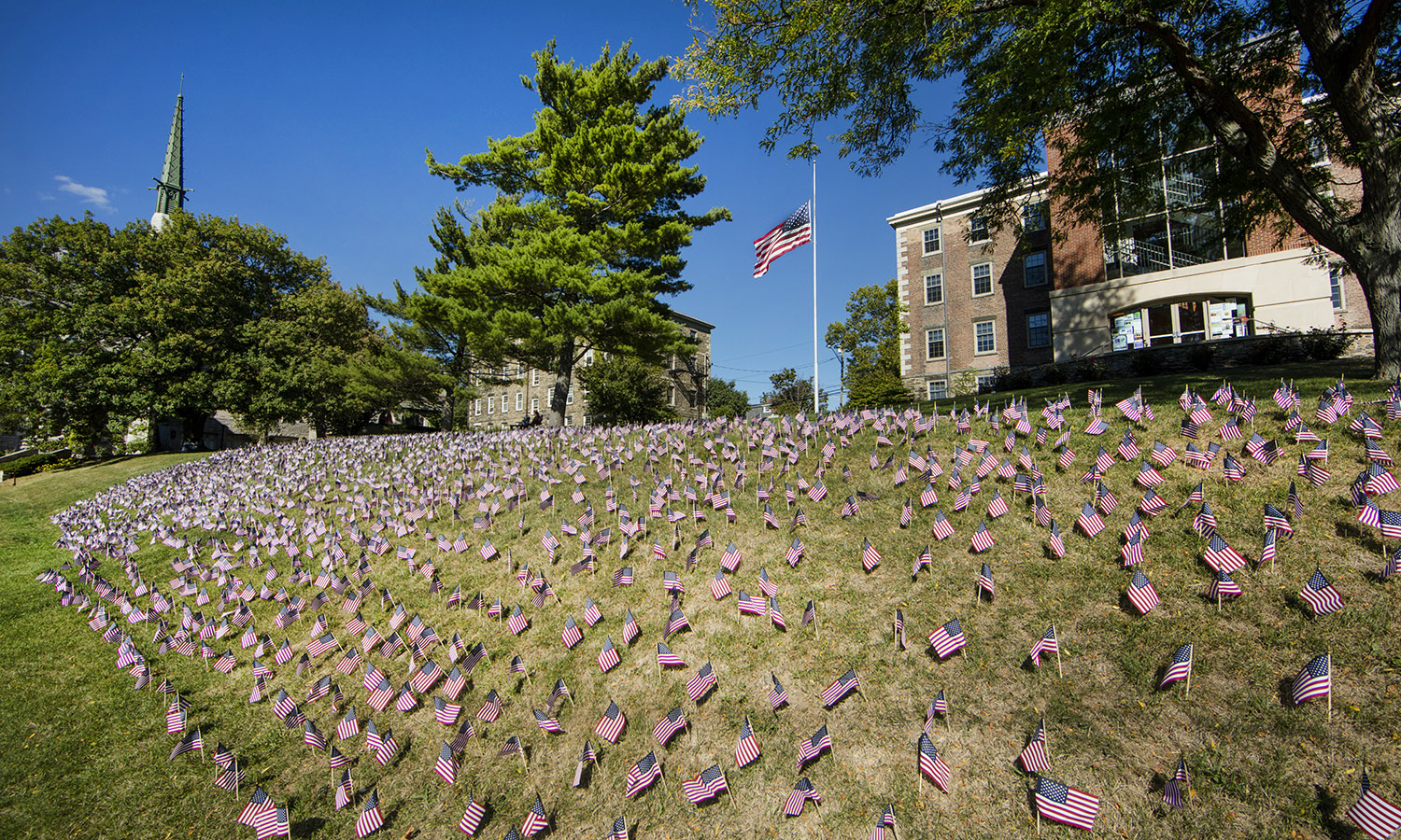 American flags placed behind Trinity by KA  in memory of the victims of 9/11