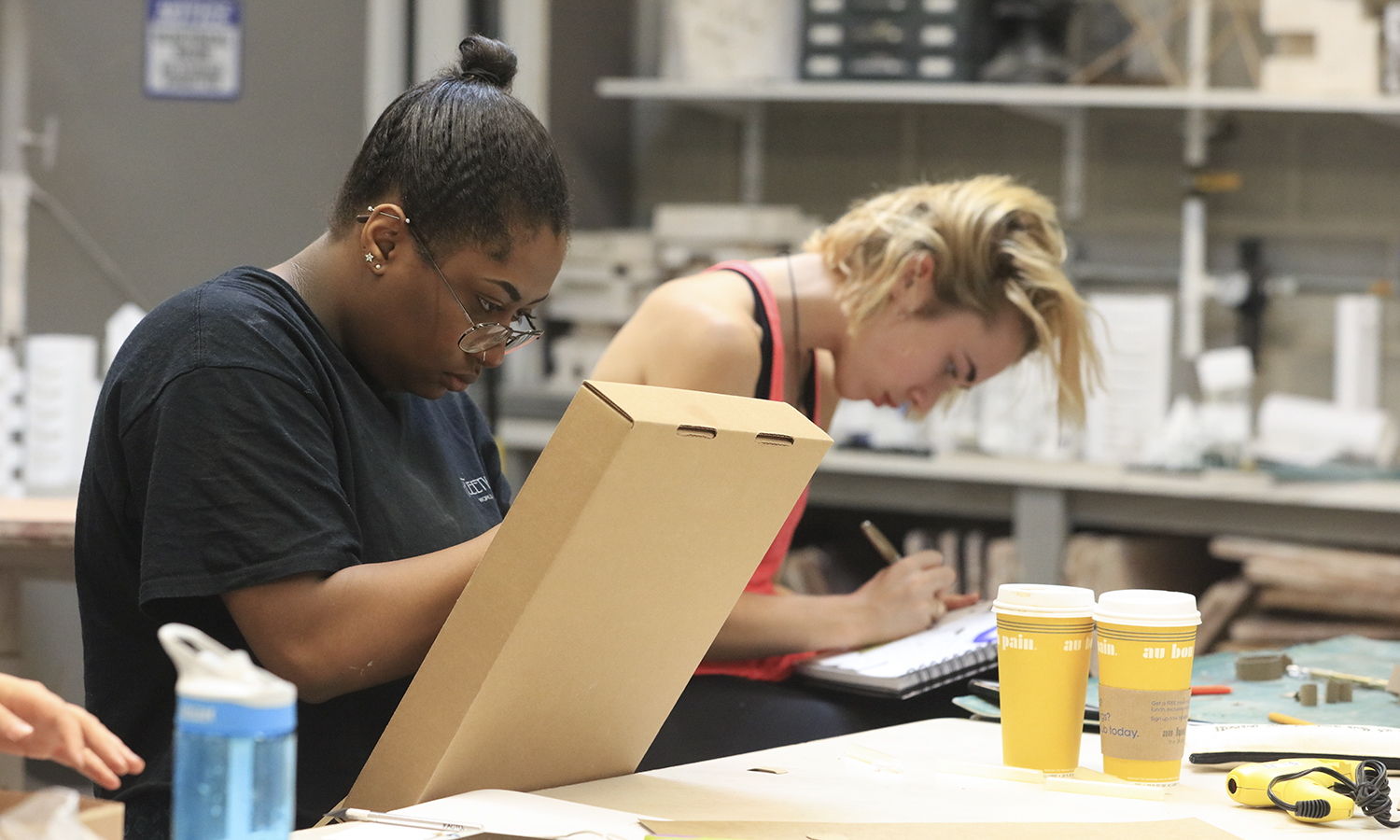 Morgan Perry '20 and Grace Hammett '20 work on projects for their Into to Sculpture class in the Elliott Art Center.