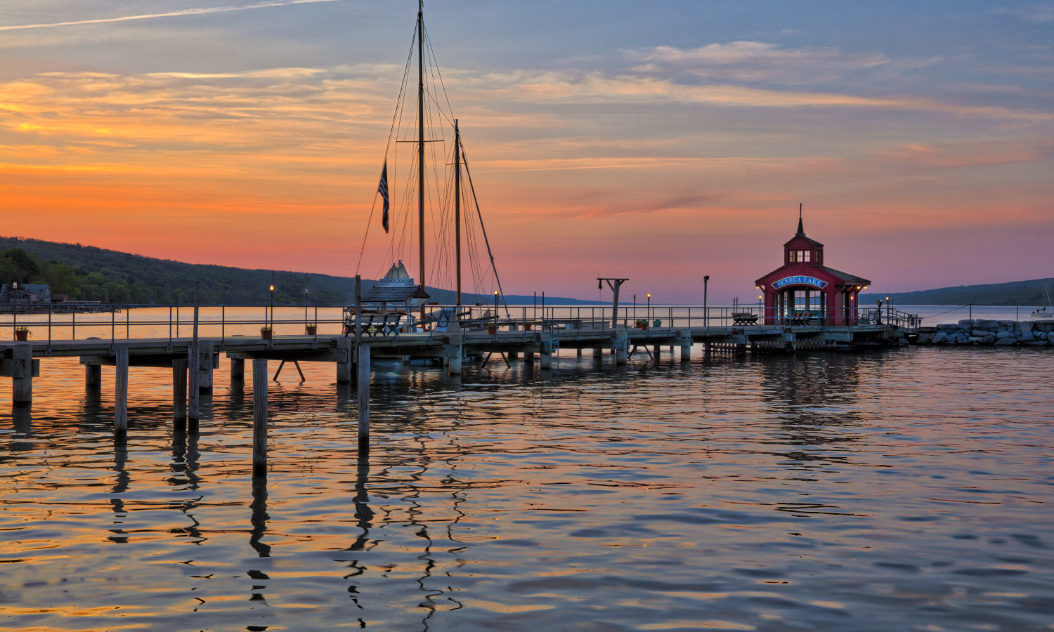 The sun sets over the Seneca Lake boathouse in Watkins Glen, N.Y.