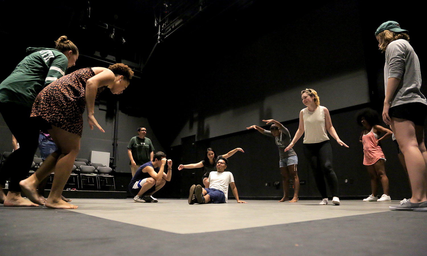 Led by Professor Heather May, students in the social justice theater group Mosaic NY perform an environment building excercise in the McDonald Theatre of the Gearan Center for the Performing Arts.
