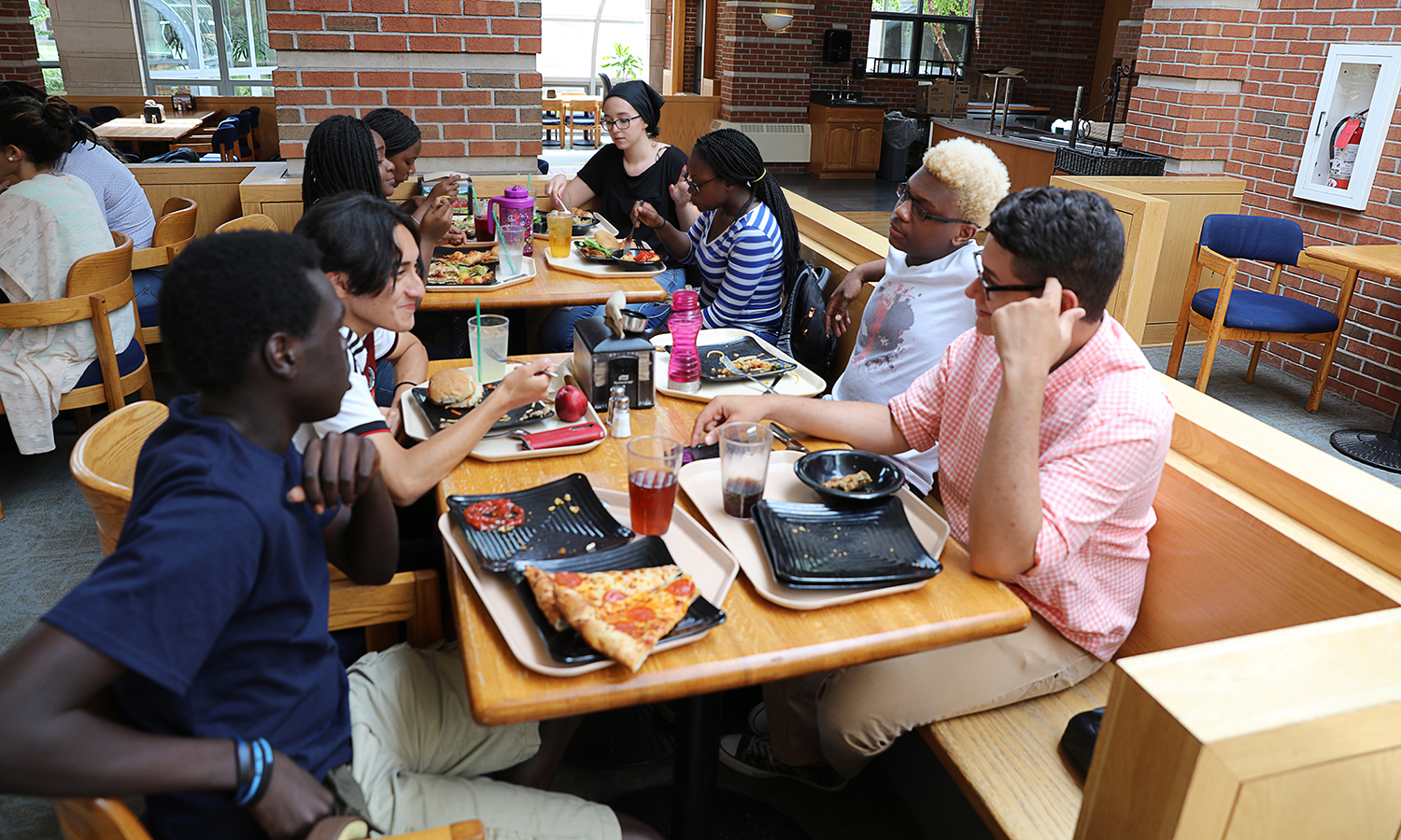 Summer students eat in the first tier of Saga Dining Hall, located in the Scandling Campus Center.