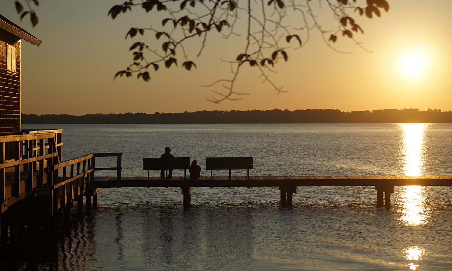 Students enjoy the sunrise over Seneca Lake at Bozzuto Boathouse, one of the most cherished campus spots for students and alums alike.