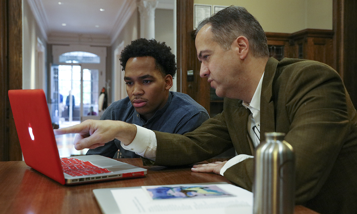 Garth Burke '18 and Associate Professor of Art and Architecture Jeffrey Blankenship review course material in Houghton House. HWS professors offer individualized support to students outside the classroom during office hours, which students are encouraged to attend regularly.