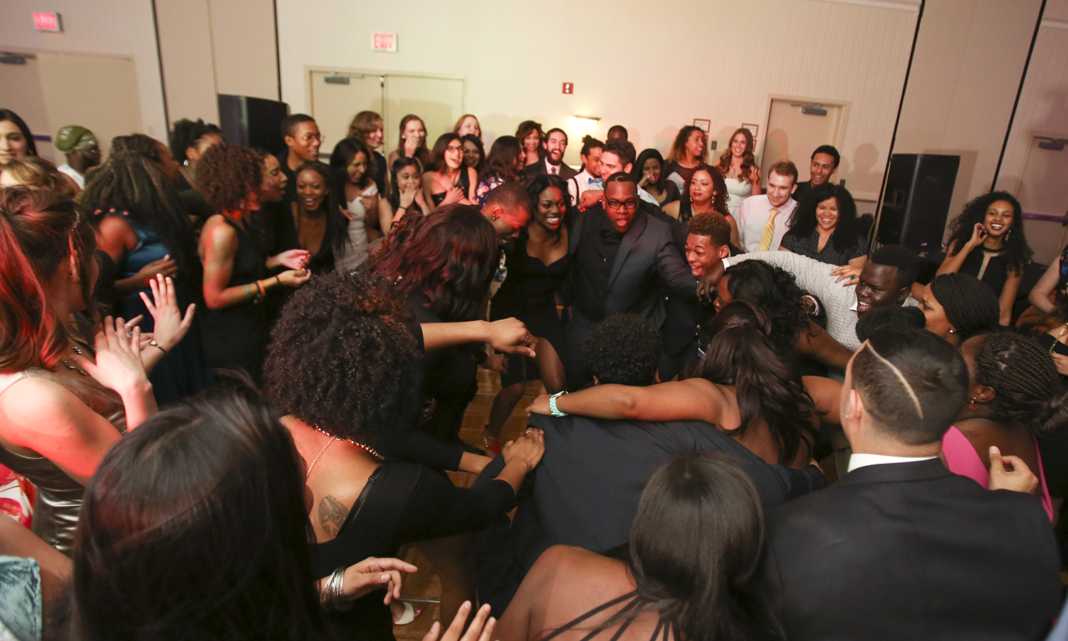 Students dance at the Ramada Geneva Lakefront during the annual Charity Ball. Members of Sankofa raised more than $2,000 for scholarships for local high school students.​