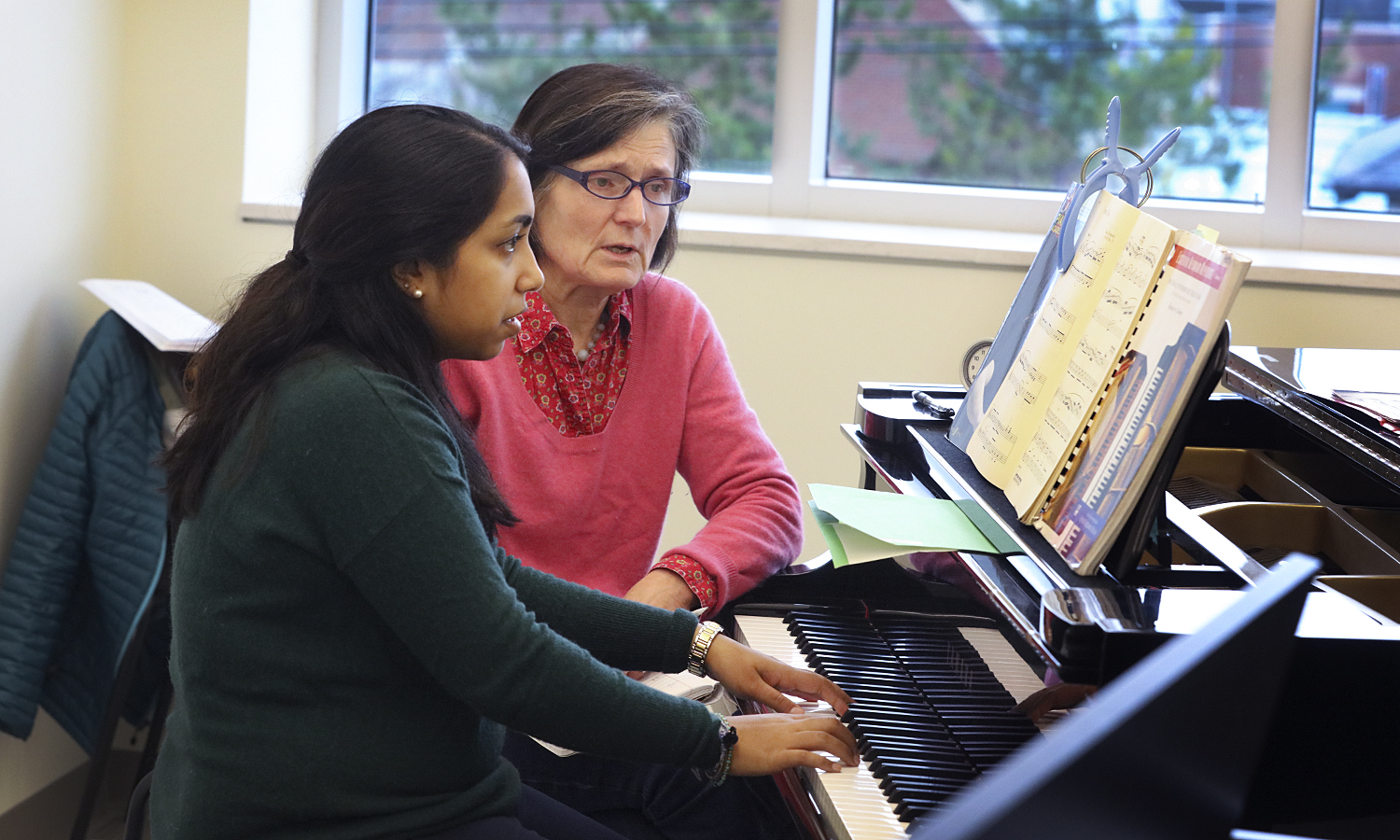Namita Neerukonda '17 XX studies during private piano lessons with Applied Instructor of Piano Meg Heaton. The Music Department offers private instruction of strings, brass, guitar, piano, percussion, voice, woodwinds, and jazz to students of all skill levels.