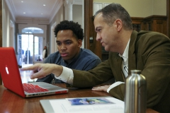 Garth Burke â18 and Associate Professor of Art and Architecture Jeffrey Blankenship review course material in Houghton House. HWS professors offer individualized support to students outside the classroom during office hours, which students are encouraged to attend regularly.