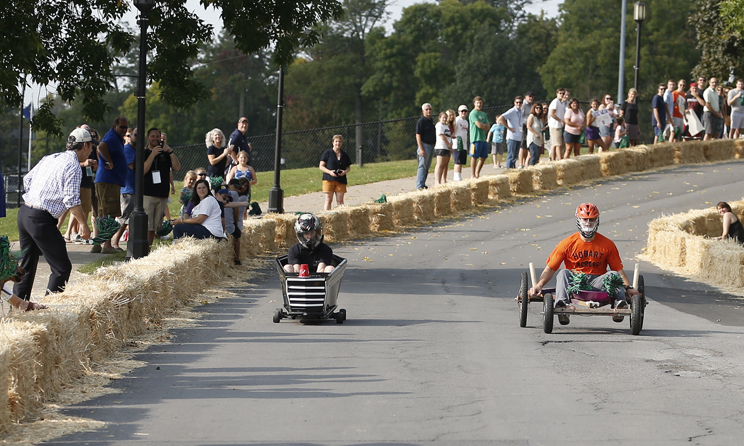 The Druid Society (right) takes the lead over the HWS Campus Safety car during Fall Nationals at Homecoming and Family Weekend.