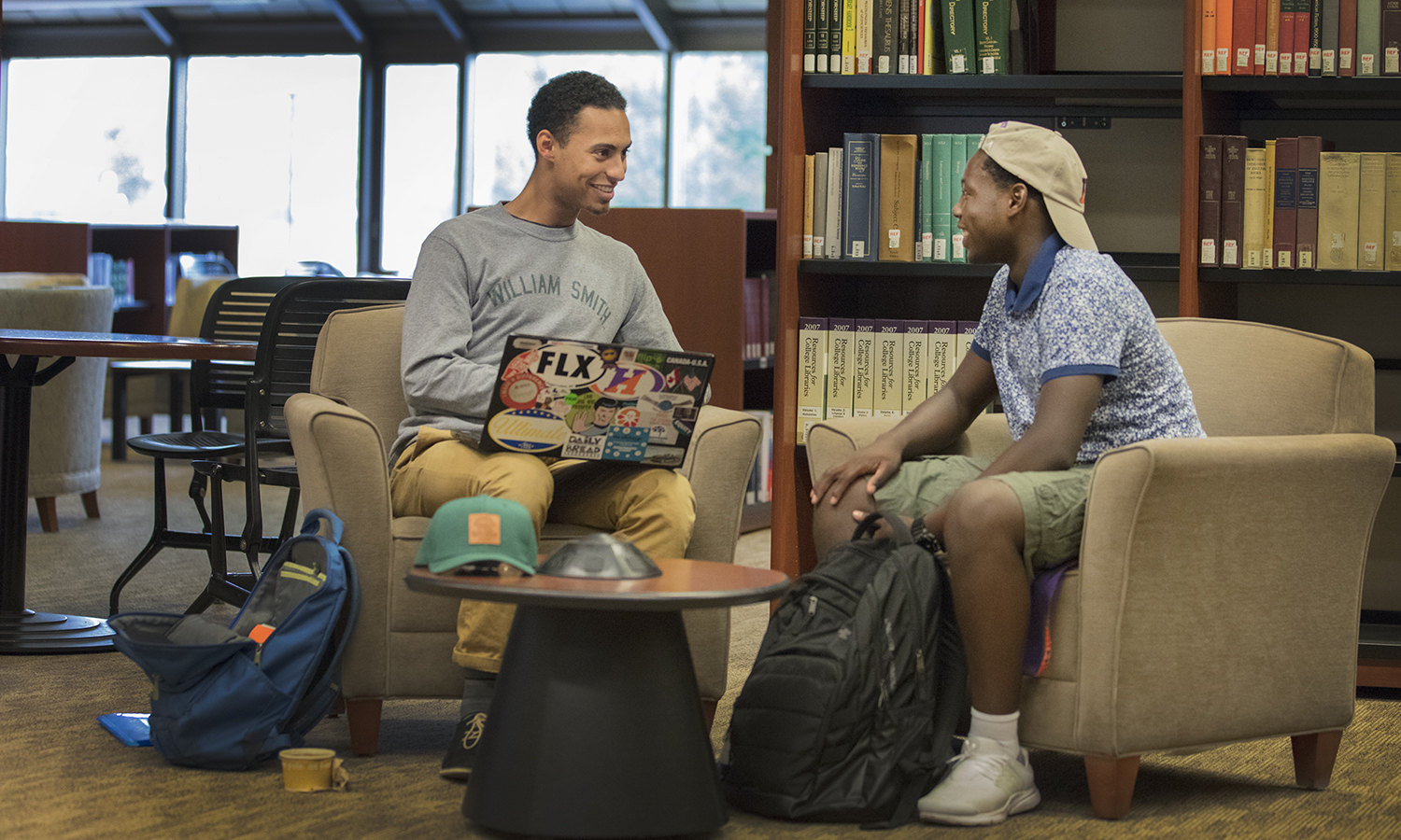 "Second-year writing colleague Donovan Hayden '19 (left) works with Aman Cumberbatch '20 on an assignment for Cumberbatch's class ""Face to Face: IInterrogating Race in the United States and South Africa"" with Visiting Assistant Professor of Africana Studies James McCorkle."
