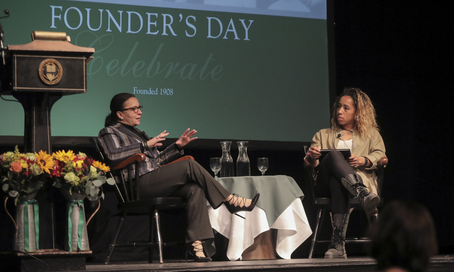 As part of the Founder's Day celebration in Bartlett Theatre, Chrysa Chin '84, an executive vice president with the National Basketball Players Association, has an on-stage conversation with Kendra Quinn-Moultrie '18, an All-Academic forward on the Herons basketball team.