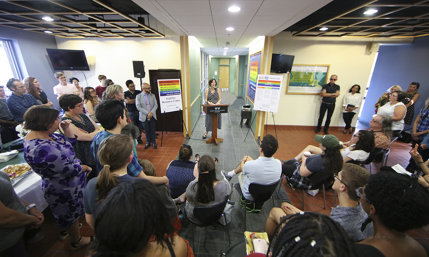 Assistant Professor of Women's Studies Michelle Martin-Baron speaks to members of the HWS Community at the opening of the new LGBTQ+ Resource Center in DeCordova Hall.