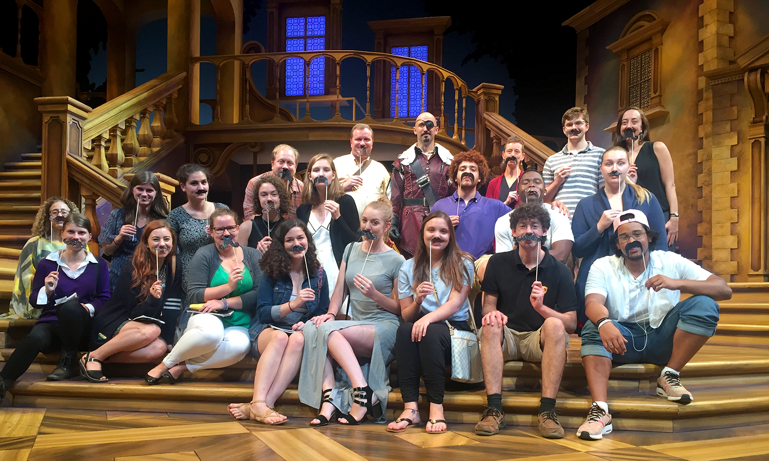 "HWS students, faculty and staff gather for a photo with Associate Professor of Theatre Chris Hatch (back row) after watching him perform in ""The Three Musketeers"" at Syracuse Stage."
