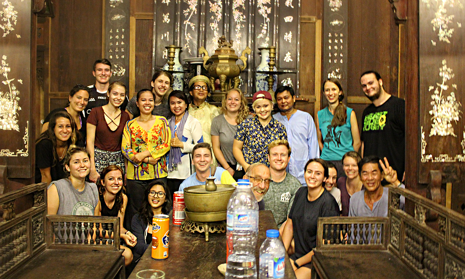 Students from HWS and Union College who are studying abroad in Vietnam gather for a photo with their homestay sponsors during an excursion to the Mekong Delta where they enjoyed a traditional Vietnamese performance.