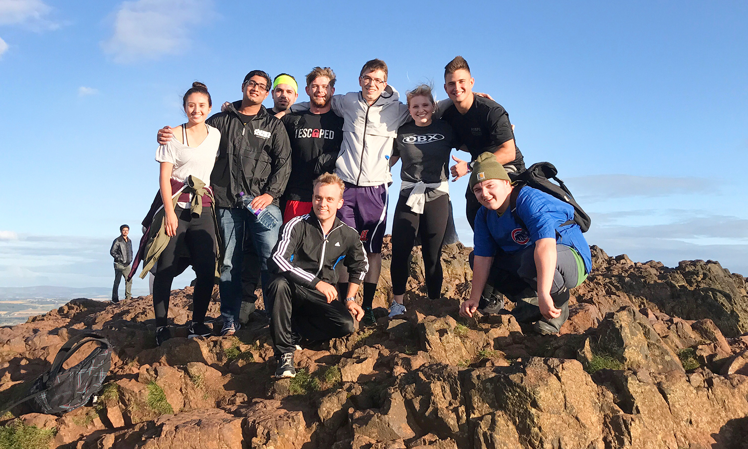 HWS students studying in Edinburgh, Scotland gather for a photo at the top of Arthur's Seat.