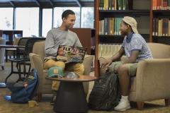 """Second-year writing colleague Donovan Hayden '19 (left) works with Aman Cumberbatch '20 on an assignment for Cumberbatch's class """"Face to Face: IInterrogating Race in the United States and South Africa"""" with Visiting Assistant Professor of Africana Studies James McCorkle."""