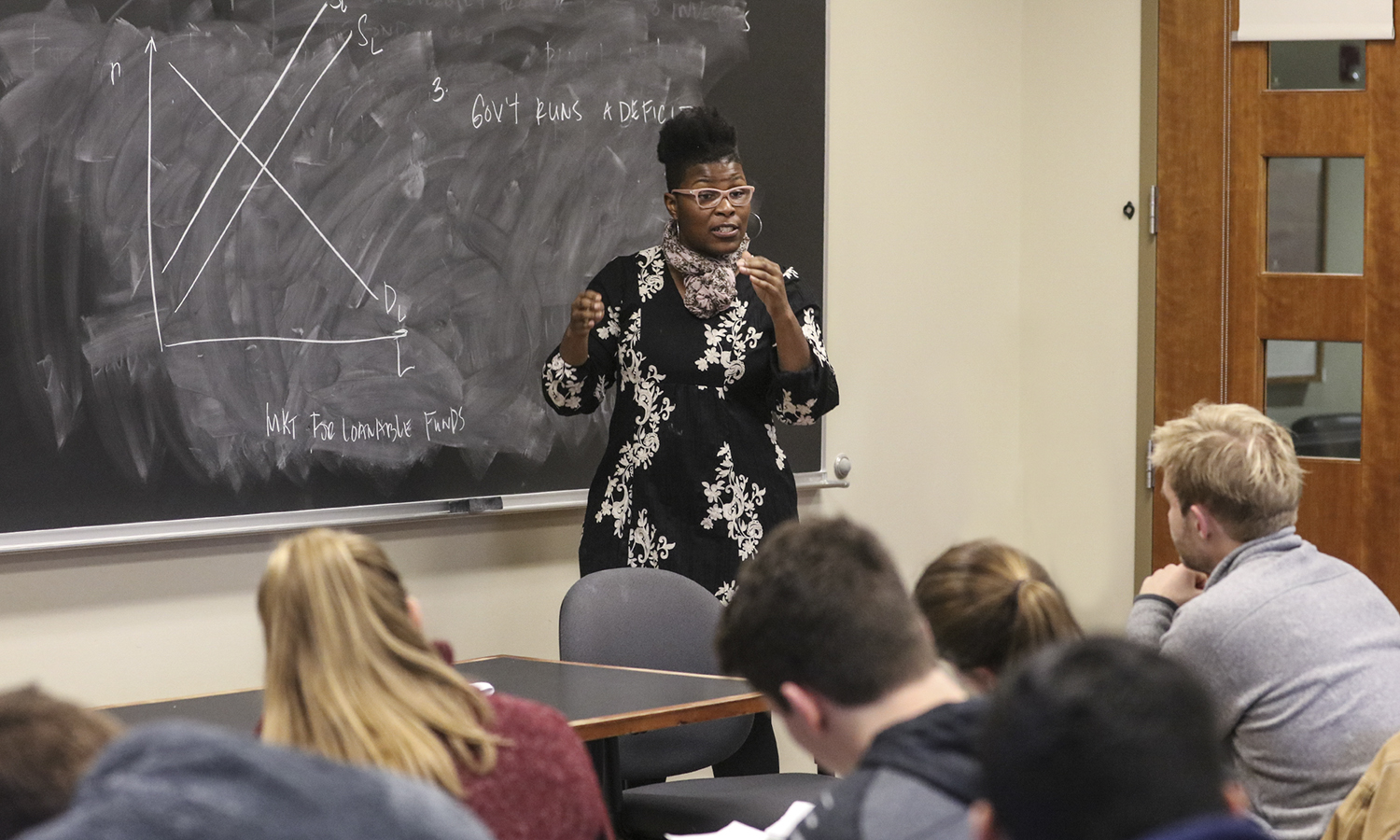 Assistant Professor of Economics Keoka Grayson teaching a Microeconomics course. She has been a member of the faculty since 2012. Microeconomics