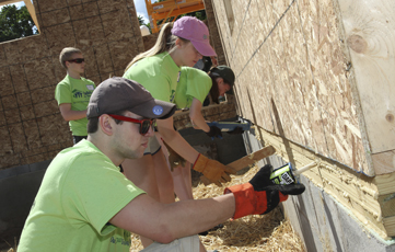 Students working on Habitat House at 24 Hawkins Ave