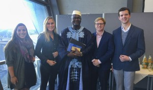 Sarah Walters '19, Ryan Montbleau '19, Elleanor Smith '18 and Soren Anders-Macleod '18 pose for a photo with Attorney General of Sierra Leone Joseph Kamara during their visit to Nuremberg for 70th anniversary of the international war crimes trial proceedings.