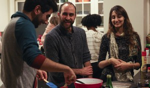 "David Lahmani 'X, Visiting Assistant Professor of French and Francophone Studies Eric Lynch and French Fulbright Professor Roxana Nabati make crepes during ""Crêpe Franco-Fête"" in the Global Perspectives Theme House."