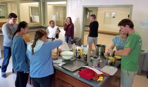 Area Coordinator for Jackson, Potter and Rees Halls Noah Lucas (right) and Sustainable Living and Learning Community teaching assistant Alyssa Kelly help students homemade granola bars. The event was organized and led by SLLC Resident Assistant Alex Cirra.