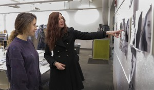 Alysia Kaplan, Assistant Professor of Art and Architecture, talks with Arianna Nasca '16 about her art project in the Elliott Studio Arts Building.