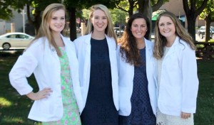 MaryAlice Spin '16,  classmate Elizabeth, Courtney Franceschi '16 and Hannah  Connolly '16 pose for a photo following their White Coat Ceremony at SUNY Upstate.