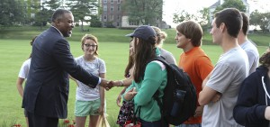 HWS President Gregory J. Vincent '83 greets students on the steps of Coxe Hall during his first day in office.