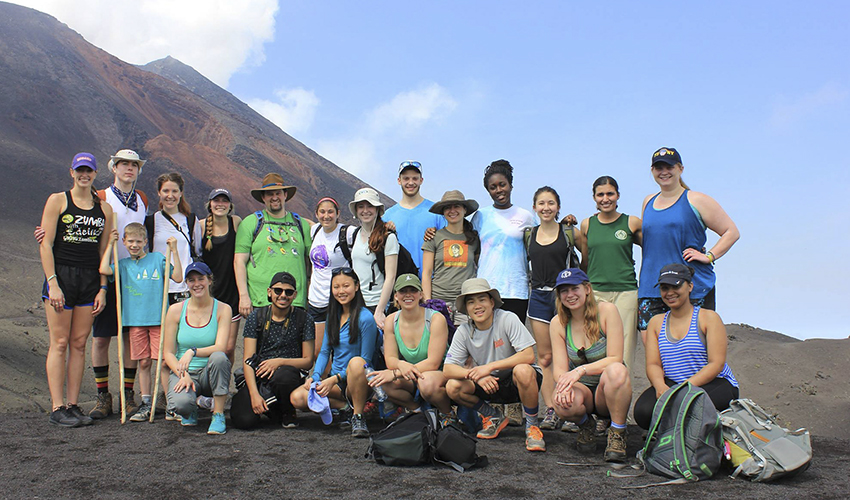 Students and faculty gather on the summit of Pacaya Volcano for a group photo. The two-week summer program to Guatemala was led by Associate Professor of Biology Meghan Brown and Assistant Professor of Psychology Brien Ashdown.