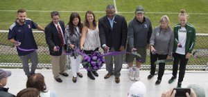 Adrian Colmenares '18, Hobart Soccer Head Coach Sean Griffin, Anne DeLaney, Emma Carver, President Gregory J. Vincent '83, HWS Trustee Chip Carver, William Smith Soccer Head Coach Aliceann Wilbur and Evie Manning '18 cut the ribbon on the newly constructed Carver-DeLaney Family Press Box at Cozzens Field.
