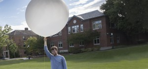 Snowden Jones '18 conducts research with weather balloons on the Quad.