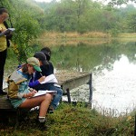 "Students collect information about the ponds at the Hanley Biological Field Preserve as part of ""Aquatic Biology"" with Associate Professor of Biology Meghan Brown."