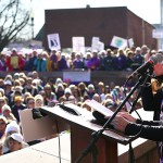 """Professor of Women's Studies and National Women's Hall of Fame board member Betty Bayer speaks at the """"Women's March"""" in Seneca Falls on Saturday."""