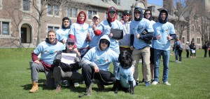 """Members of the Kappa Alpha Fraternity and """"Hank"""" the dog pose for a photo on the Quad before heading to the """"Geneva Peeps"""" site for Day of Service."""