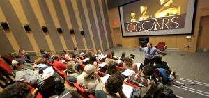"""Professor of Media and Society Lester Friedman speaks to students in his class """"Imagining the West"""" in the Fish Screening Room of the Gearan Center for the Performing Arts."""