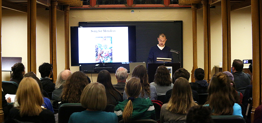 "Assistant Professor of English and Comparative Literature Geoffrey Babbitt delivers a reading from his new book, ""appendices pulled from a study on light,"" in the Blackwell Room on Wednesday."
