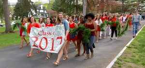 Members of the William Smith Class of 2017 lead a procession down the Hill to the Moving Up Day ceremony on Stern Lawn.