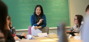 """Associate Professor of History Lisa Yoshikawa speaks with students during """"The Asia Pacific Wars"""" in Trinity Hall."""