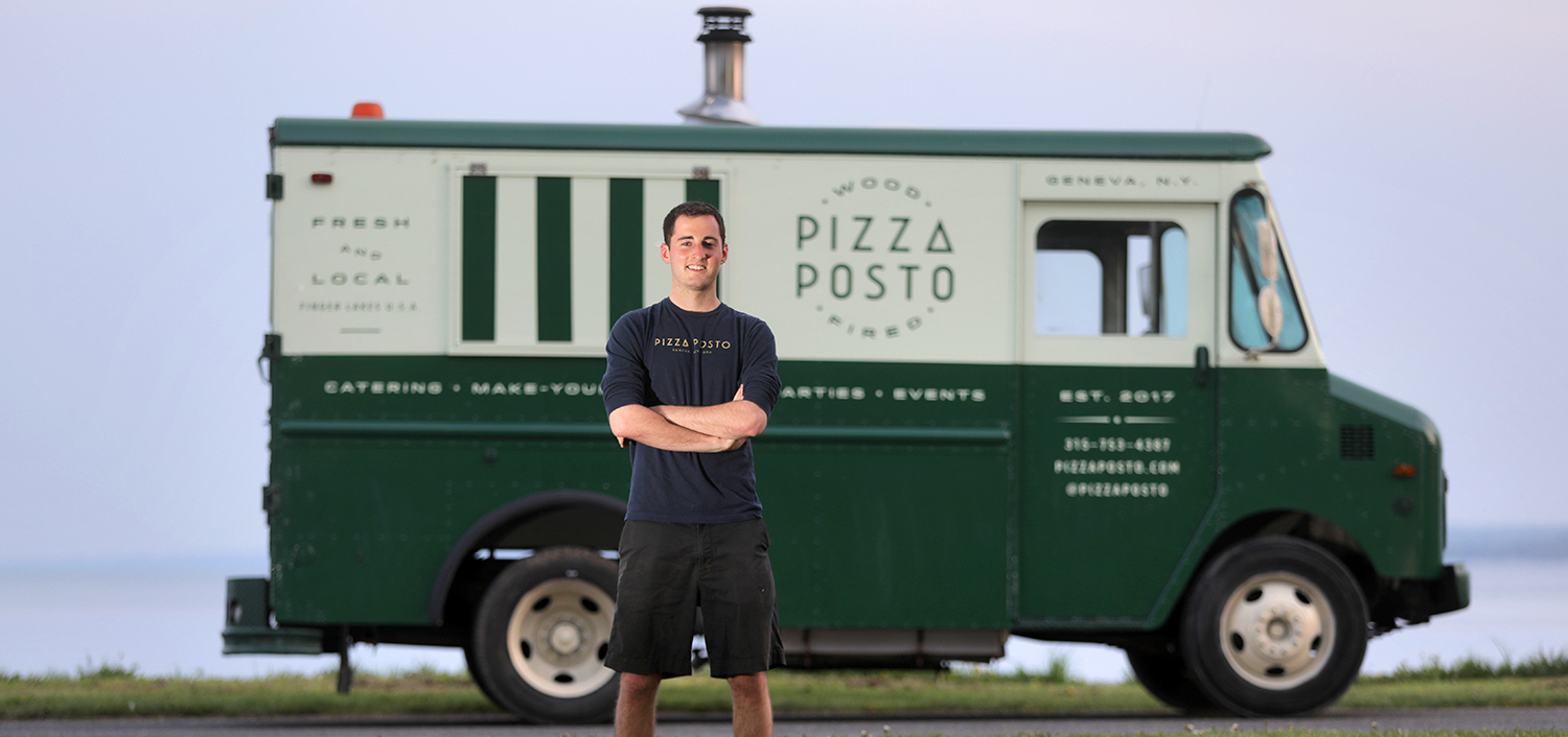 "Since winning the 2017 Stu Lieblein Pitch Contest, Sam Solomon '17 has launched ""Pizza Posto"" a food truck delivering locally-sourced and wood-fired pizza to pop-up locations and special events throughout the Finger Lakes Region. ""Pizza Posto"" will be serving up pizza during the Friday night celebration at HWS Reunion."