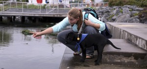 "April Moffett '21 shows Seneca Lake to ""Odyssey"" during a ""Guiding Eyes for the Blind"" training session at Star Park in Geneva, N.Y."