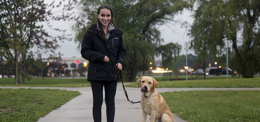 Jamie Soucie '20 poses for a photo with Nalani, a recent Guiding Eyes graduate, at Star Park in Geneva, N.Y.