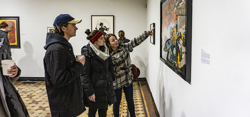 "At the Davis Gallery at Houghton House, students observe artwork on display from the collection ""Art and Labor: Works from the Art Collection."" The exhibit will be on display through March 1st."